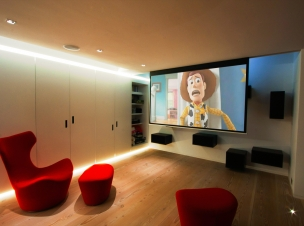 A JVC X-30 projector delivers crisp images on this hidden motorised 2.5m metre screen